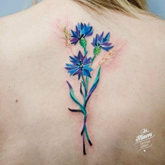cornflower tattoo design on back for females