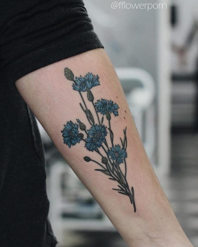 cornflower tattoo design on forearm for men