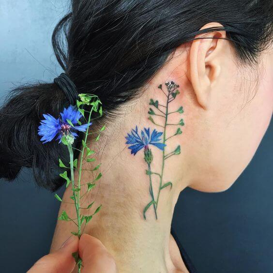 cornflower tattoo on side neck for women