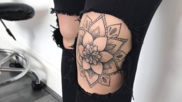 dotwork mandala tattoo design on knee