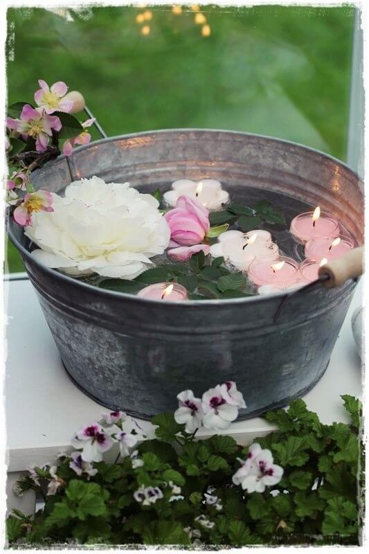 lighting bucket candles for summer garden party