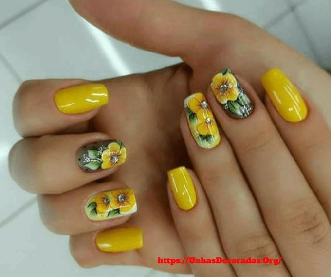 yellow nails decorated with yellow flowers stickers