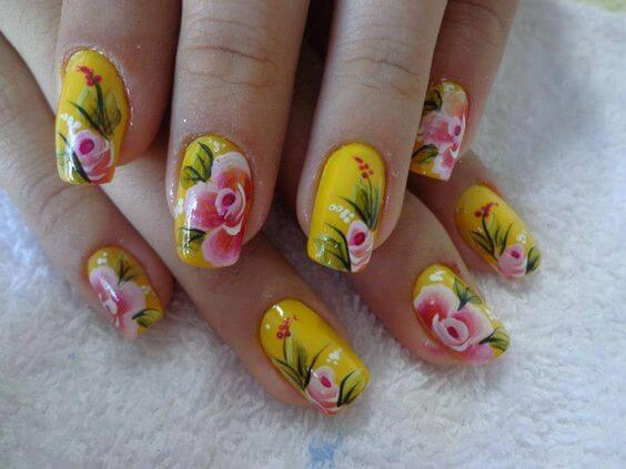 yellow nails with pink flowers
