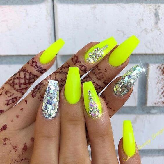 yellow neon nails with rhinestone