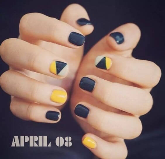 yellow and black nails with geometric shape designs