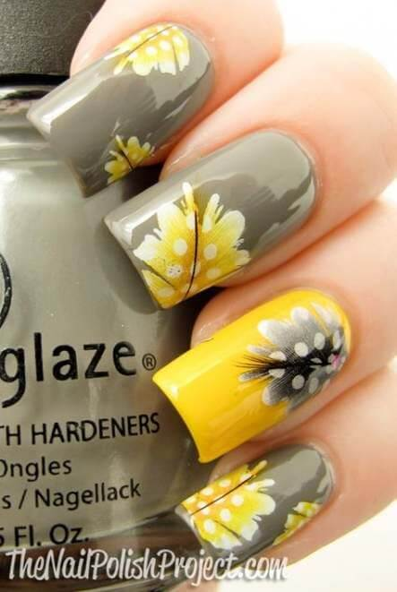 yellow and grey nails with floral designs