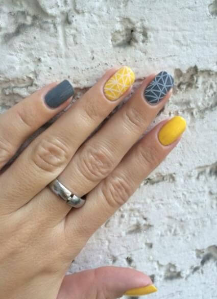 yellow and grey nails with geometric designs