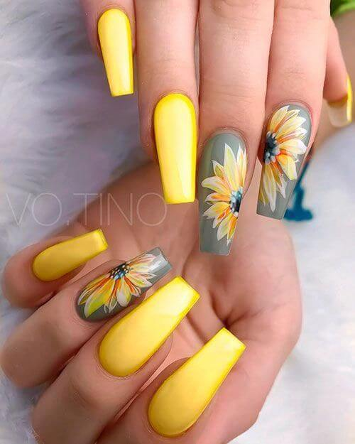 yellow coffin and grey nails with flowers