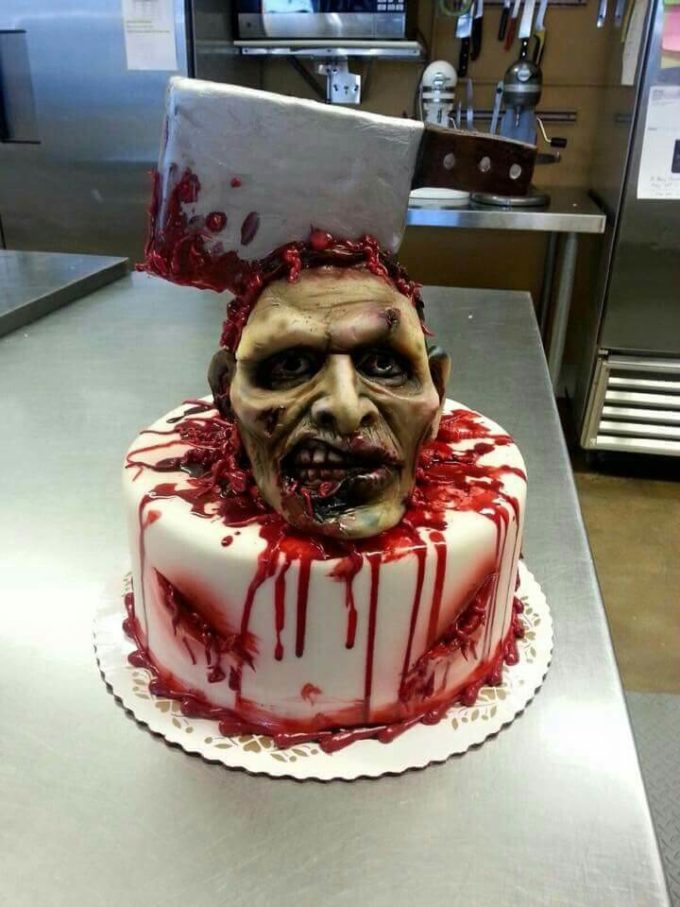 axe on a zombie's head wedding cake for halloween