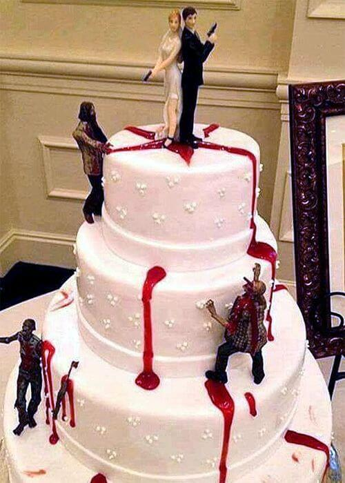 bride and groom killing the zombies wedding cake