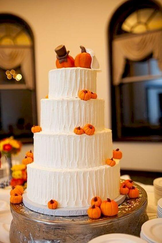 cute white and orange pumpkin halloween wedding cake
