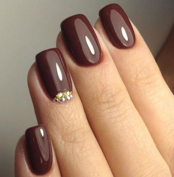 dark chocolate color nails with rhinestones