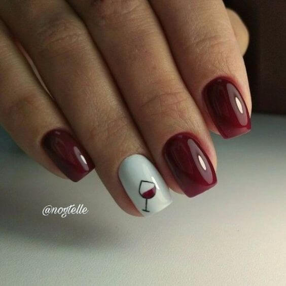 shiny gel nails with wine glass