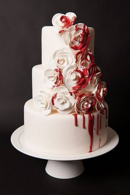 white halloween wedding cake with blood red roses