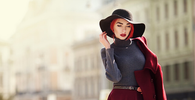 beautiful girl wearing fedor hat with short hair