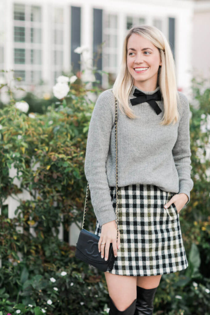 bow with grey sweater and plaid print miniskirt outfit ideas for christmas chruch services