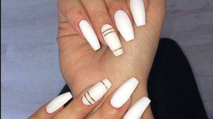 long white coffin nails with golden stripes