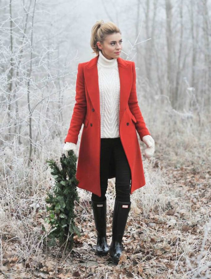 red coat with white sweater and black pant christmas outfit ideas for females