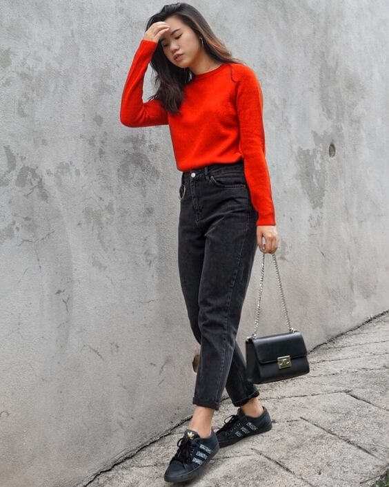 red sweater and black jeans christmas outfit ideas for girls