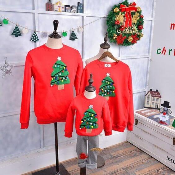 family matching christmas tree sweater outfits