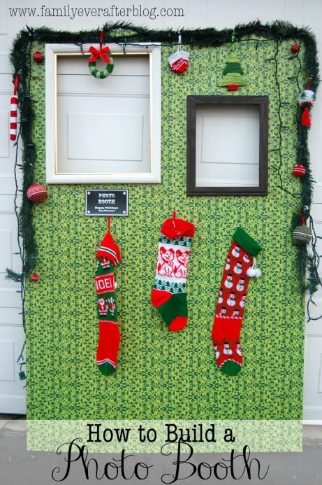 ugly christmas sweater photo booth with hanging decorations