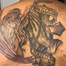 angel with in gods hands banner tattoo design and praying hands-rosary-cross on back