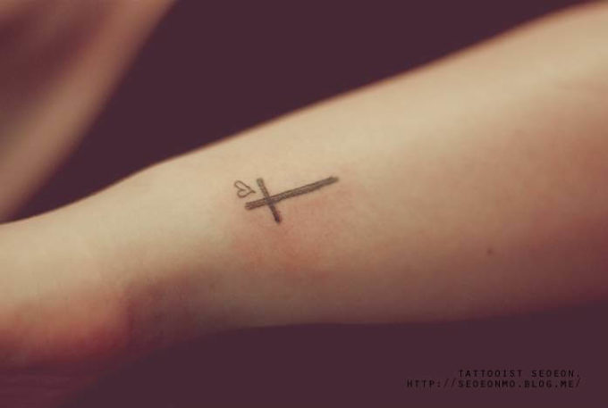 cross and heart tattoo design on side wrist