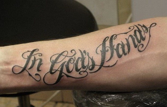 in gods hands script font tattoo design