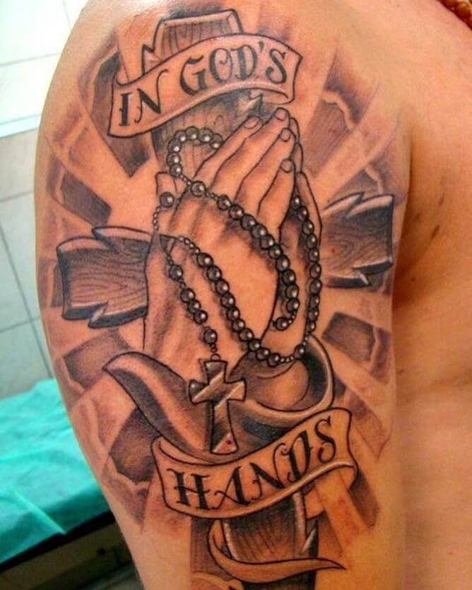 in gods hands tattoo design banner in clouds with praying hands and rosary-cross on shoulder
