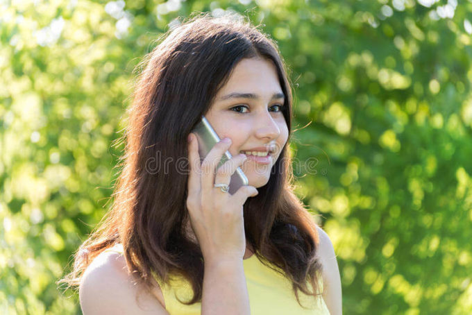 cute girl chatting on phone the thing that guys love the most