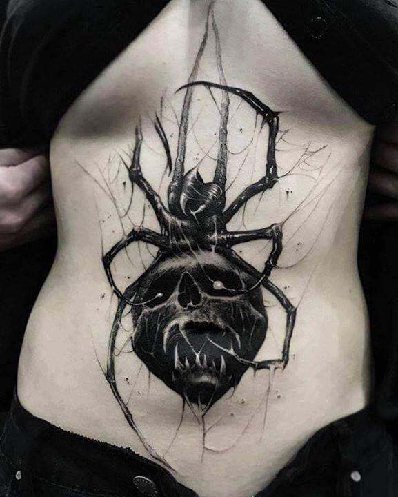 spider skull tattoo design on stomach for girls