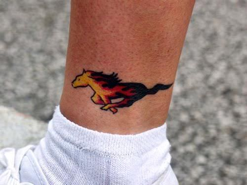 flame mustang pony tattoo on ankle