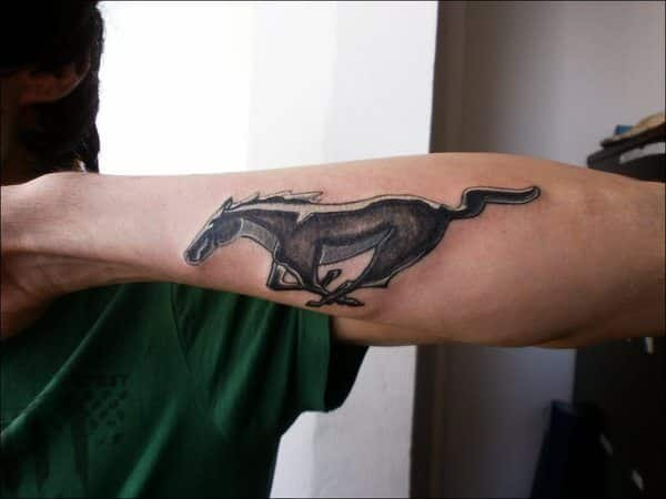 ford mustang logo tattoo on forearm