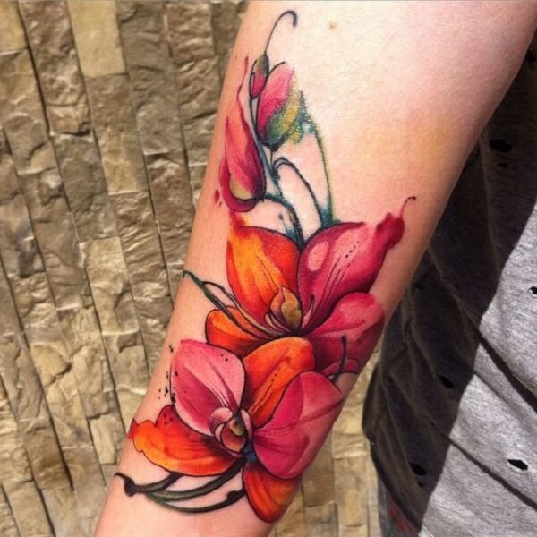 colorful orchid flower tattoo design on arm