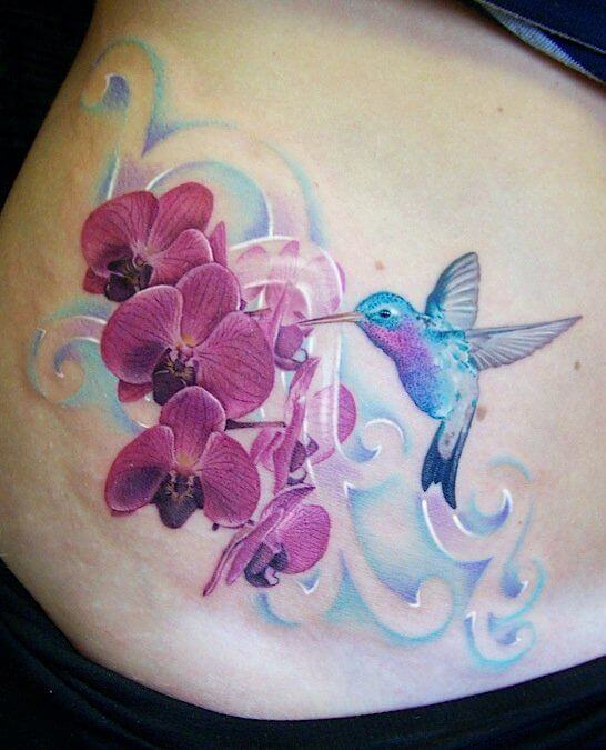 hummingbird and orchid flowers tattoo design on stomach