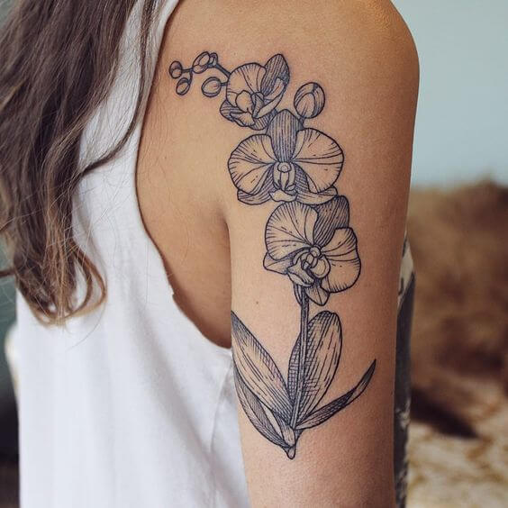 outlined orchid floral tattoo design on back hand