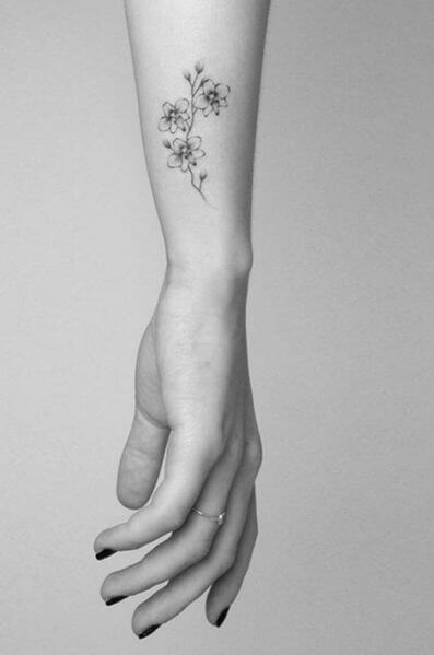 tiny monochrome orchid flowers tattoo on side wrist for females