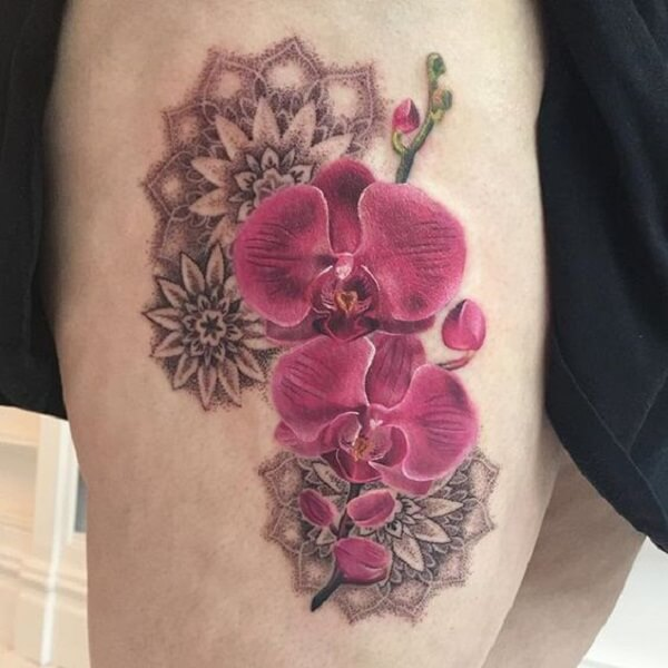tribal orchid flower tattoo on thigh