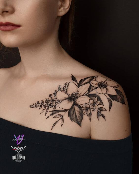 black and white jasmine flower tattoo on shoulder