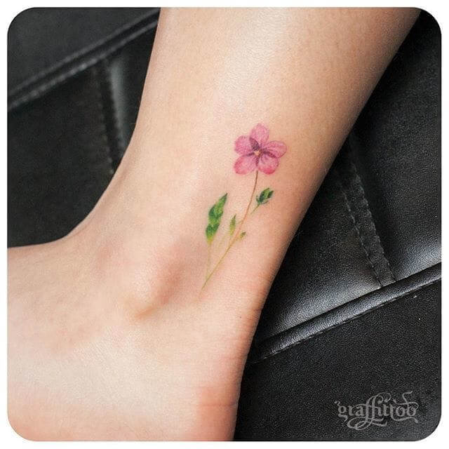 subtile jasmine flower tattoo design on ankle