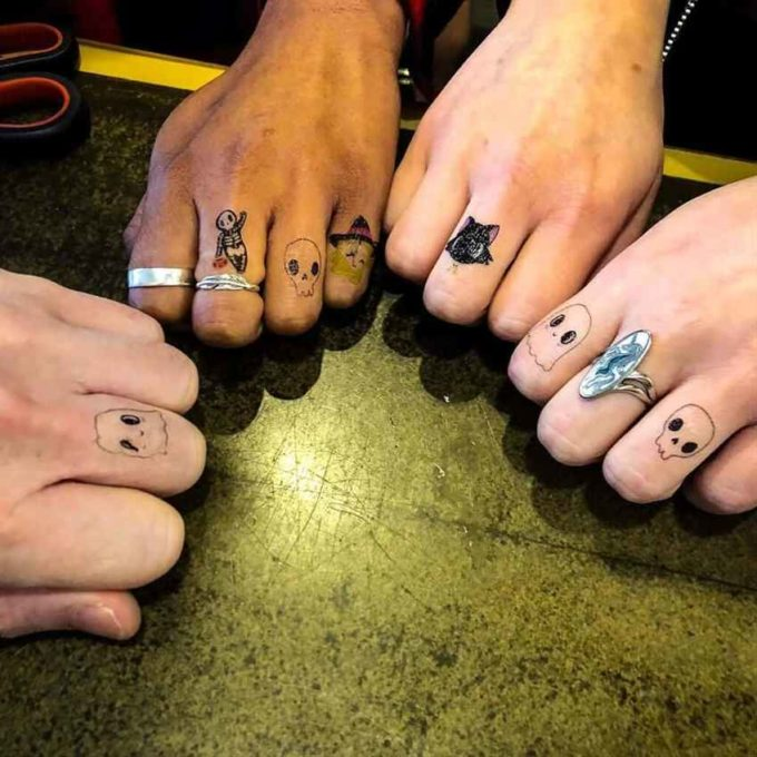 cute small  ghosts halloween tattoos on fingers