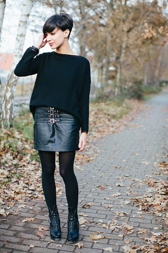 short leather buckled skirt outfit with short hair
