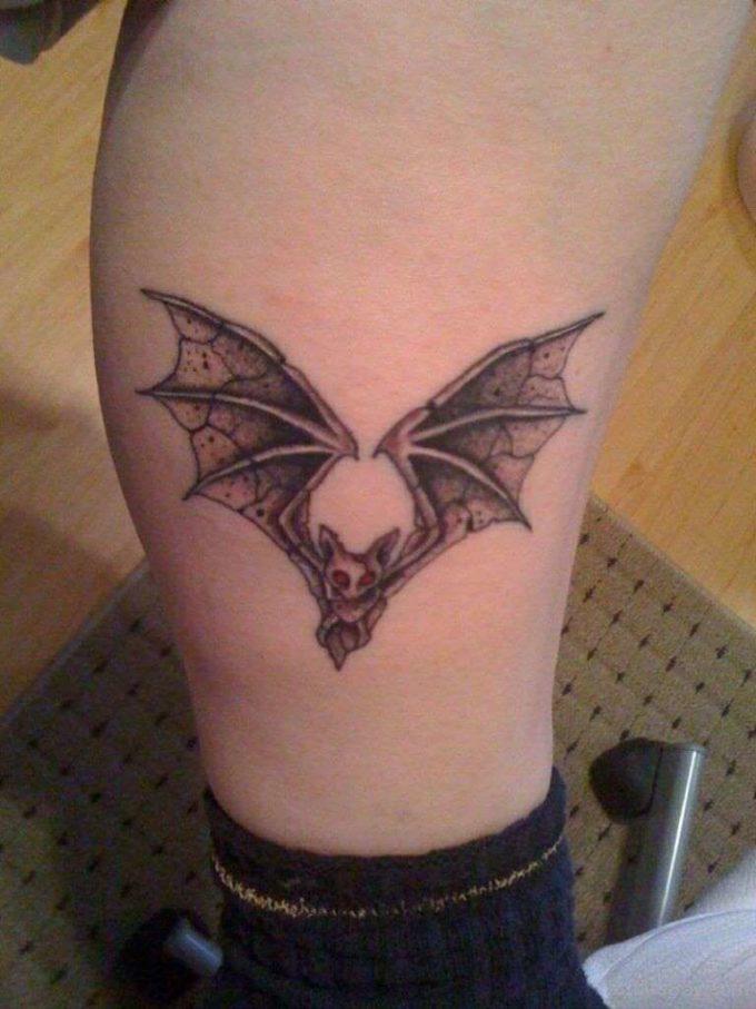 elvira bat tattoo on leg
