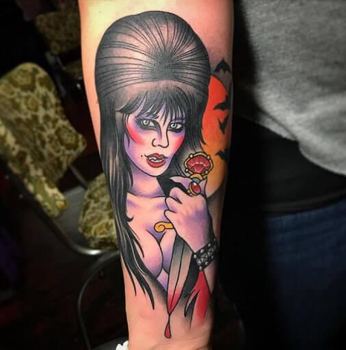 elvira with dagger tattoo