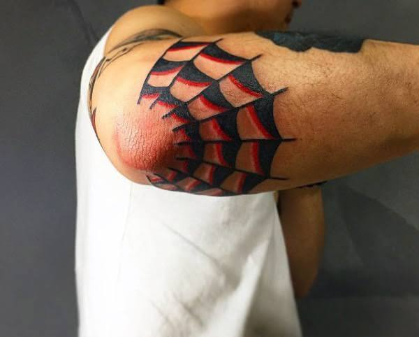 old school spider web elbow tattoo
