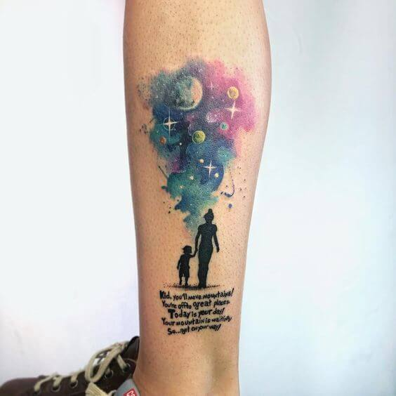 watercolor quote and astronomy tattoo on leg